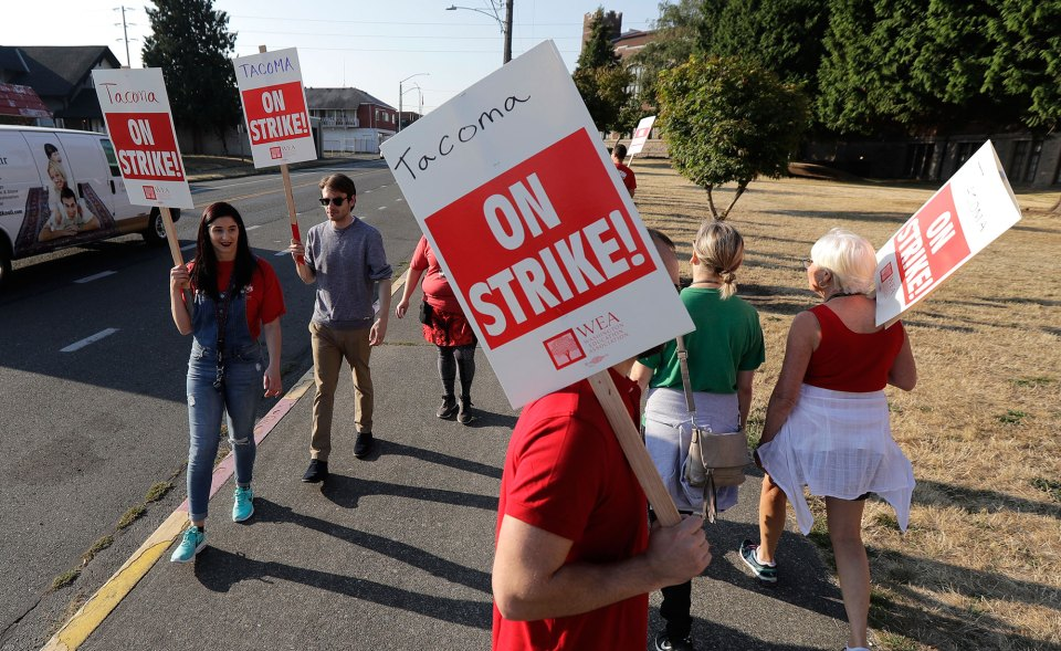 Teacher strikes: Striking Tacoma Teachers walk a picket line, Thursday, Sept. 6, 2018, in front of Lincoln High School in Tacoma, Wash. Fights over teacher salaries and work conditions are escalating along the West Coast, and the disputes are particularly acute in Washington, a state that has infused at least $1 billion for teacher pay to resolve a long-running court battle.
