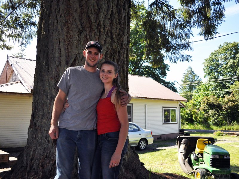 """Hunter Blair and his fiancée, Ronnie Kinsman, pose in the field behind their home on June 2, 2018, in Onalaska, Washington. The pair graduated from Onalaska High School in 2017 and 2016 respectively, and say they intend to settle down in their hometown. """"It's beautiful country up here,"""" Kinsman said. """"Why leave something that we love?"""""""