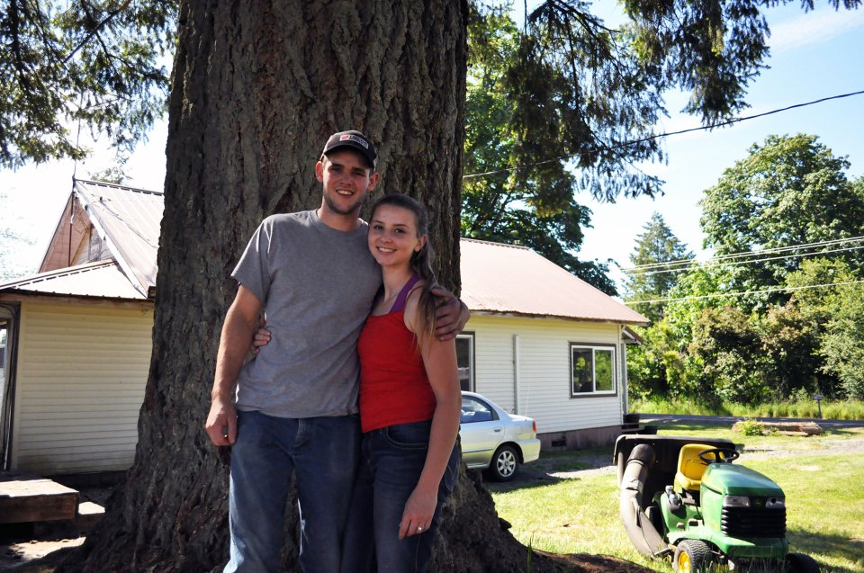 "Hunter Blair and his fiancée, Ronnie Kinsman, pose in the field behind their home on June 2, 2018, in Onalaska, Washington. The pair graduated from Onalaska High School in 2017 and 2016 respectively, and say they intend to settle down in their hometown. ""It's beautiful country up here,"" Kinsman said. ""Why leave something that we love?"""