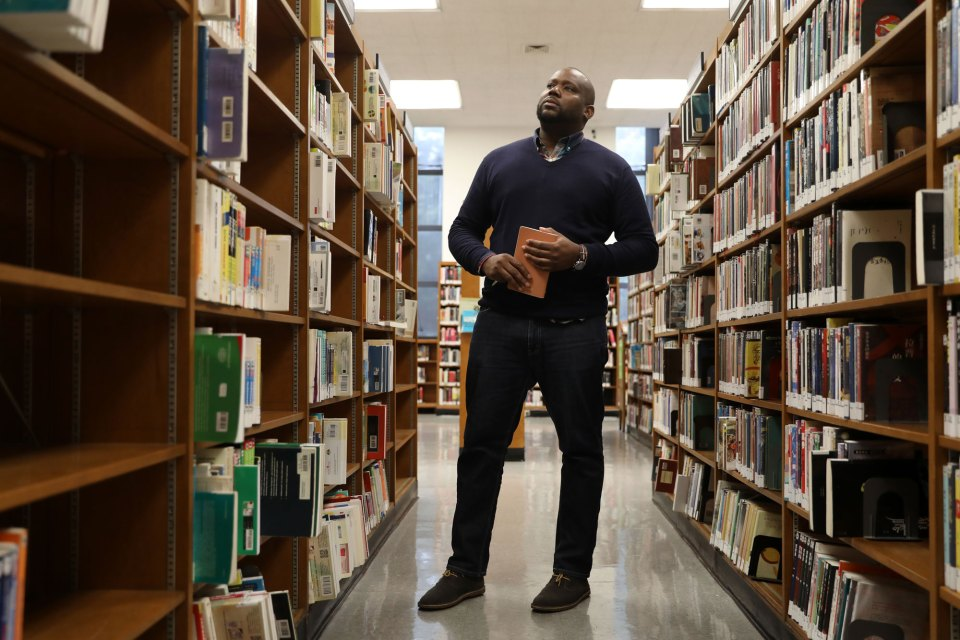Purvis Thompson poses for a portrait at the Brooklyn Public Library after taking an anthropology class offered by Bard College on October 16, 2018. Bard College has opened a micro-college, offering associates degrees earned by attending classes at the Brooklyn Public Library at Grand Army Plaza.