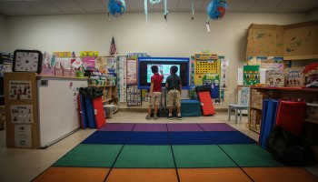 Liam Frometa, 5, left, and Christopher Ramos, 5, right, play with their classroom's smart board at Fun Time Early Learning Academy in Naples, Fla. The academy is able to provide smart boards due to funding from the Naples Winter Wine Festival.