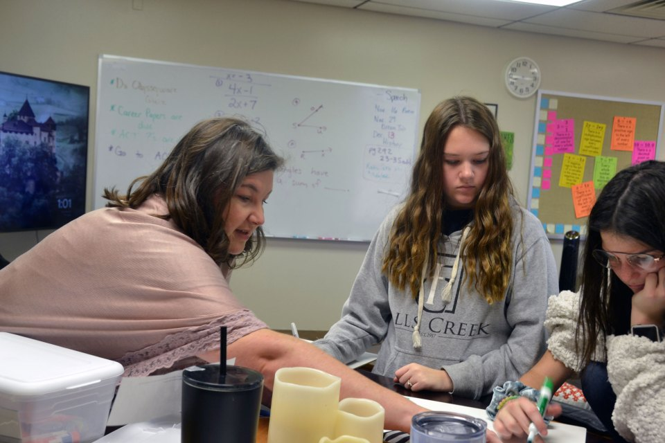 Math teacher Charity Hobbs helps her students prepare for the ACT test. Hobbs taught in a small school in Shawnee, Oklahoma, before joining the Academy of Seminole charter school when it opened this fall.