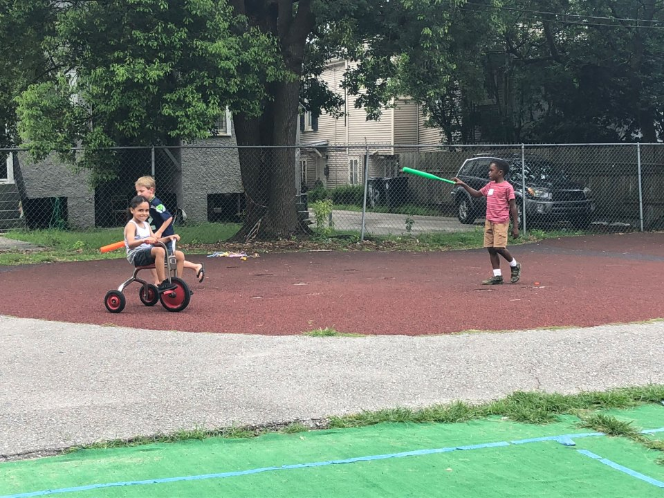 Children play in the school yard of Noble Minds, a charter school in New Orleans. Noble Minds puts a particular focus on offering therapy and social-emotional learning classes to students.