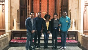 The Thompson family, (from left) Clive, CJ, Christine, Oneita and Timothy, stand in the sanctuary of the First United Methodist Church of Germantown, where the parents and their two youngest children have been living since August.