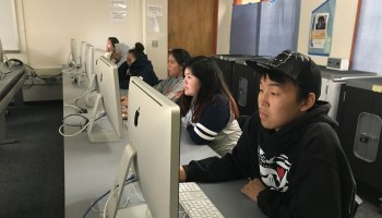 Nome Public Schools students take state tests in the high school computer lab. With greater bandwidth on a new fiber-optic internet connection, the district hopes to avoid the frequent crashes that have plagued students and staff in the past.