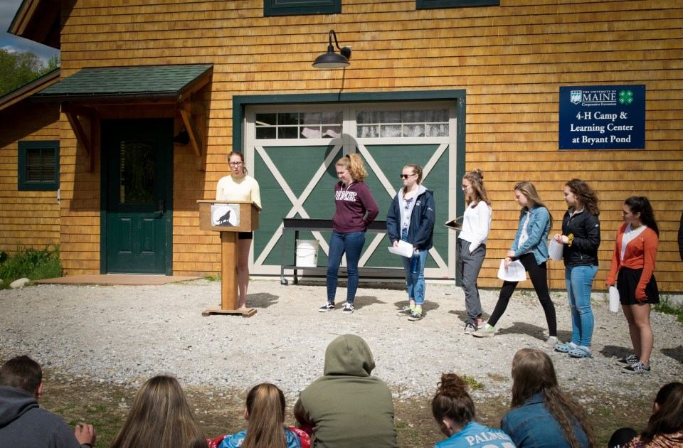 Demonstrating confidence and speaking about the responsibilities she has fulfilled, EB Hoff, 14, announces her candidacy for class treasurer at the Telstar Freshman Academy's 4-H center campus in rural Maine.