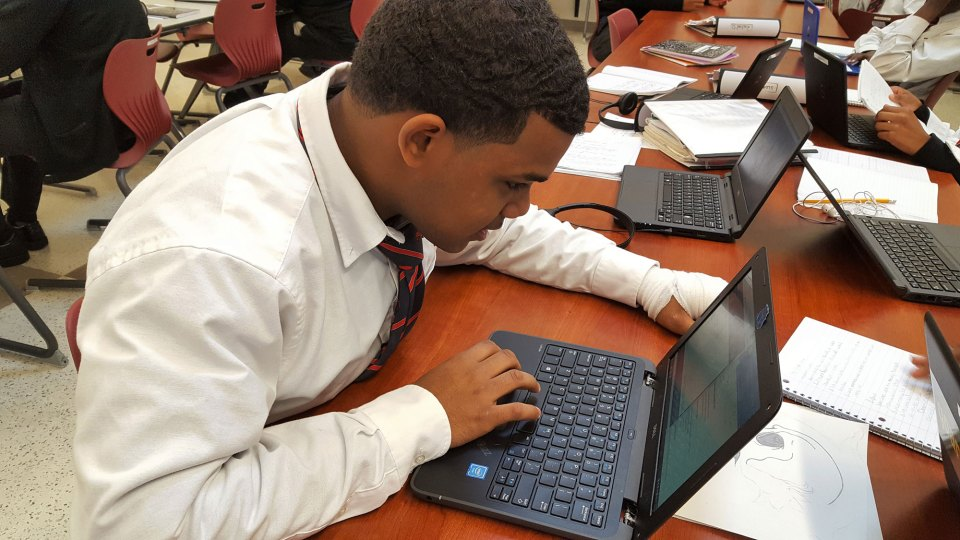 Michael Mota, 17, gets to learn at his own pace through online coursework at Vertus High School in Rochester, New York.