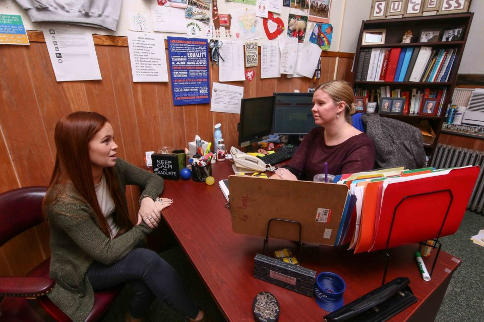 Chestnut Hill College director of student success Kim Cooney meets with senior Erin Crowley. Cooney changed her major at the end of her junior year in college, adding an extra semester to the time it took to graduate. Now she tries to help others make the right decisions sooner.