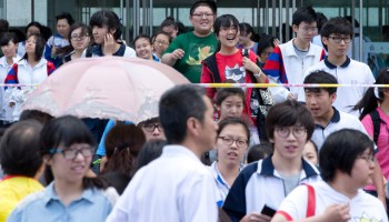 Students leave a high school after they finished a Chinese literature exam, the first of four exams of the two-day college entrance exam, in Beijing Saturday, June 7, 2014. More than nine million students will compete in this year's national college entrance exam across China for less than seven million college seats. (AP Photo/Alexander F. Yuan)