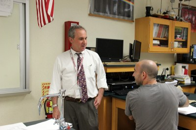 Principal Josh Mandel visits a science classroom during one of many daily rounds. Mandel says that acknowledging the achievement gap between students was key to improvement. (Photo: Jackie Mader)