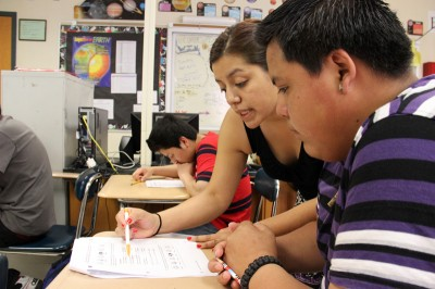 Marisol Wager, a science teacher, assists a student in her bilingual science class. Ossining High School offers two science courses and one math course for students who are native Spanish speakers. (Photo: Jackie Mader)