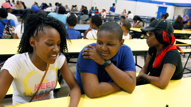 D'Andre's sister, Jaida (left), has attended four Newark schools in the years he has been at Quitman. Their mother, Taneka (right), has both their names tattooed on her left arm. (Amanda Brown / NJ Spotlight)