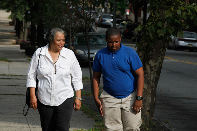 Jean, 68, walks her grandson D'Andre up the hill to school every day. (Amanda Brown / NJ Spotlight)