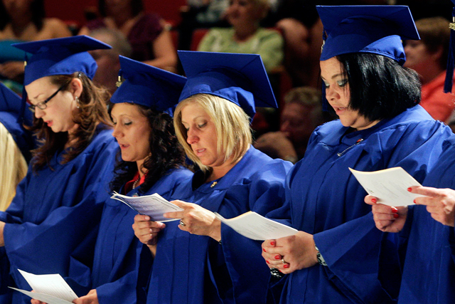 File photo of a group of graduating Richland Community College students recite an oath after receiving their nursing pins in Decatur, Ill. (AP Photo/Herald & Review, Mark Roberts)