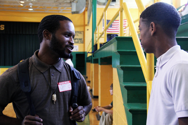 Alfonso Franklin, a project manager for the Mississippi Center For Justice, talks to a young man in his Youth in Transition program. Franklin's program aims to keep youth out of jail by keeping them in school and providing jobs and mentors. (Photo by Jackie Mader)