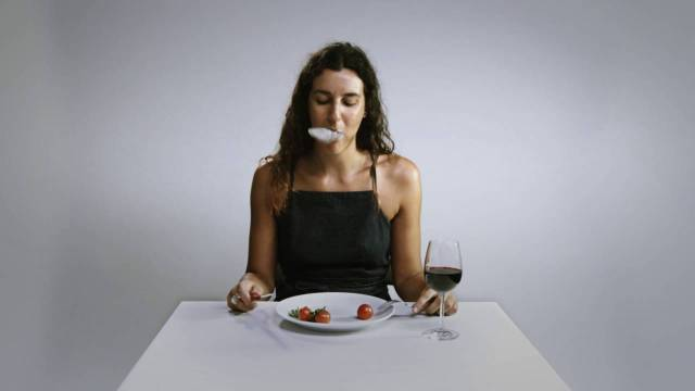 woman eating plastic