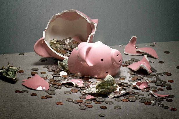 broken-piggy-bank-with-money-spilling-out