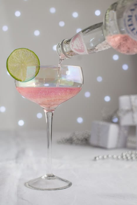 Pouring a pink elephant cocktail