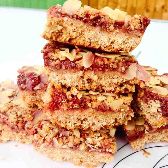 Breakfast peanut slices with crumble and strawberry chia jam