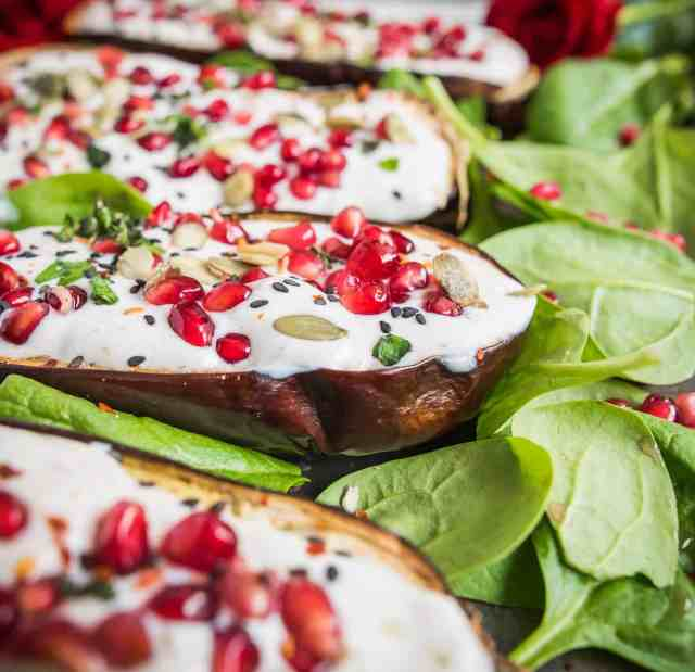 Spicy roasted aubergine recipe bursting with flavours and colours served with creamy yoghurt dressing, pomegranate and sunflower seeds. Vegan & gluten free.