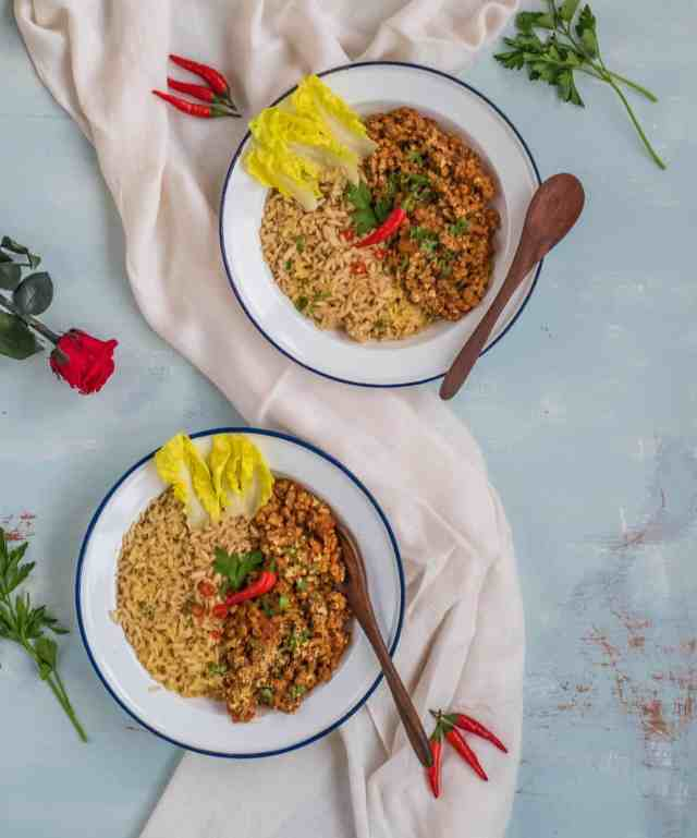 A simple, budget friendly and very tasty healthy Bolognese recipe made with soya or veggie mince, herbs and spices topped up with fresh parsley and chillies #vegan #dairyfree #veganuary