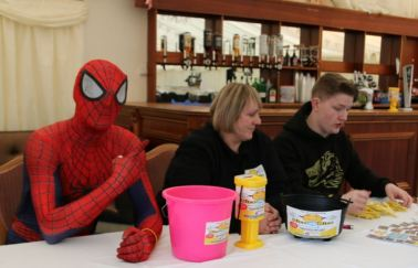 Spiderman lends a hand at the Nice 2b Nice charity firewalking event