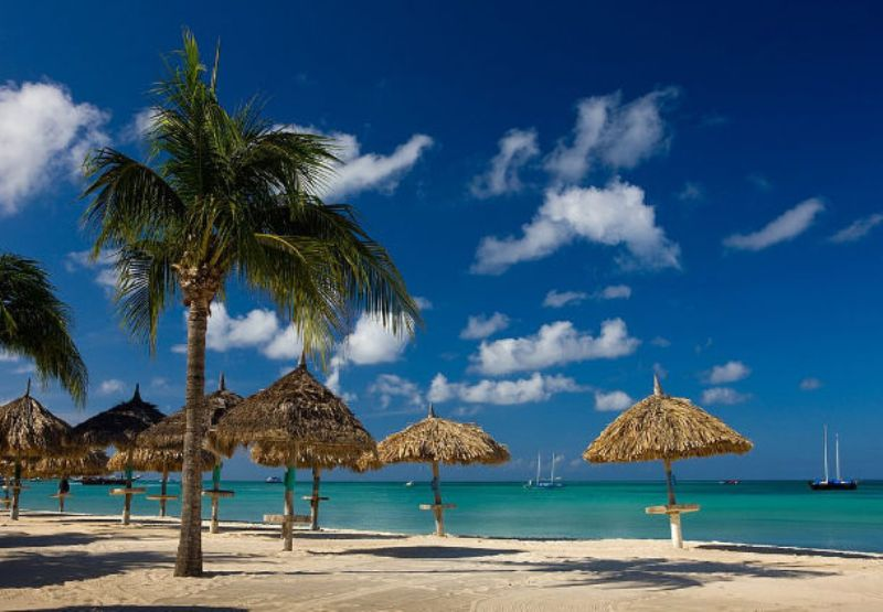 Spring Break Vacation - beach palapas - courtesy of Aruba Marriott Resort -Stellaris Casino