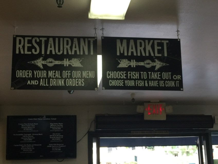 Captain Kidd's Market and Restaurant signs