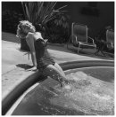 marilyn-monroe-1926-1962-wearing-a-bathing-suit-and-with-her-legs-in-a-swimming-pool-circa-1951-photo-by-archive-photos-getty-images-1951