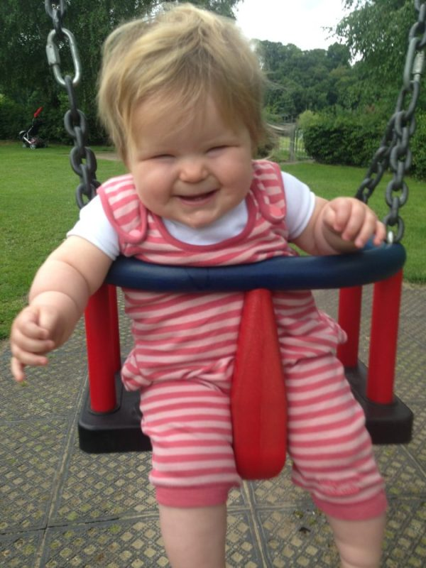 baby girl on swings
