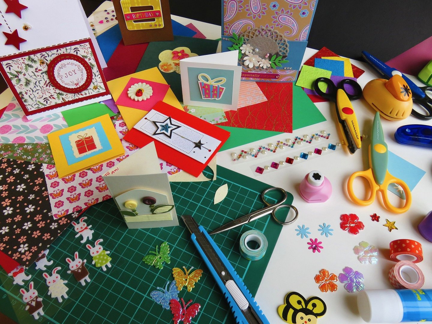 Flatlay of craft materials being used to make Christmas cards