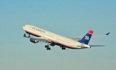US Airways and American Airlines post-merger loyalty points, elite status, and alliance.
