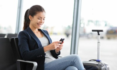 woman aiport mobile booking shopping