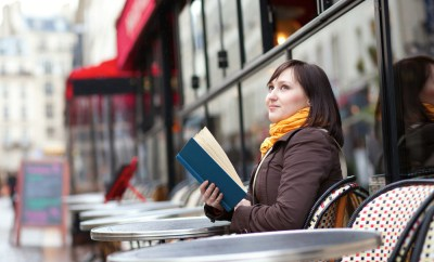 Woman dining solo outdoor cafe menu