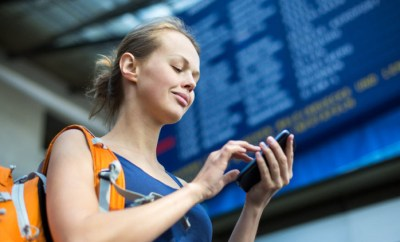 women at station airport on phone