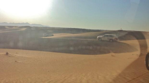 Al maha desert resort dune bashing cars small dunes