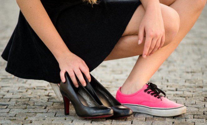 woman switching heels for sneakers
