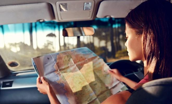 shutterstock_126992147 Woman Viewing Map