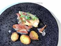 Kip in room met parmezaan aardappeltjes