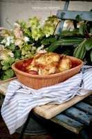 Kip in tomatensaus uit de römertopf