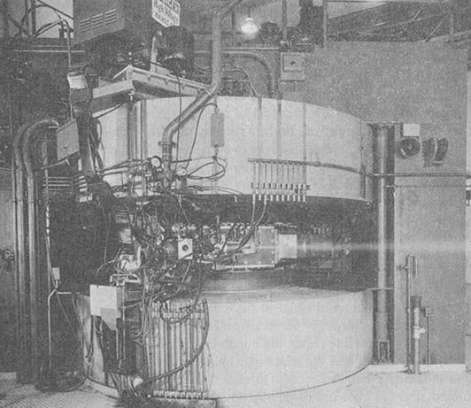 FIG.1 60 inch cyclotron showing off extracted beam. 14 MeV D's loosed into the room excite nitrogen in the air. Approximately 1950.