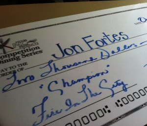 Chef Jon Fortes gets the BIG check for his Fire in the City win!!