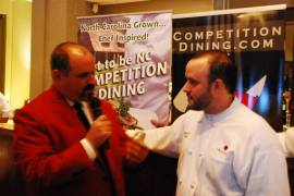 Competition Dining host Jimmy Crippens interviews Chef Jon Fortes at the dinner's end