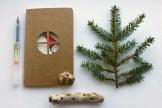 Illustrated Christmas Moleskine journal with peeking elf at window