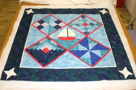 Quilt top finished and pinned to the wadding and backing, ready to start machine quilting it.