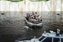 Remote control migrant boat ride - by Banksy