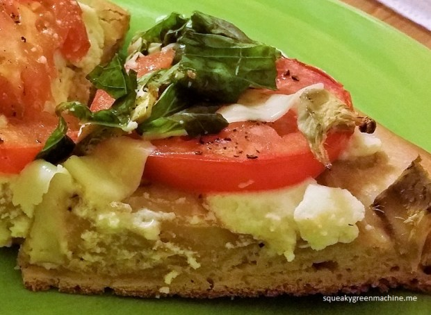 homemade pizza with ricotta, tomato and basil