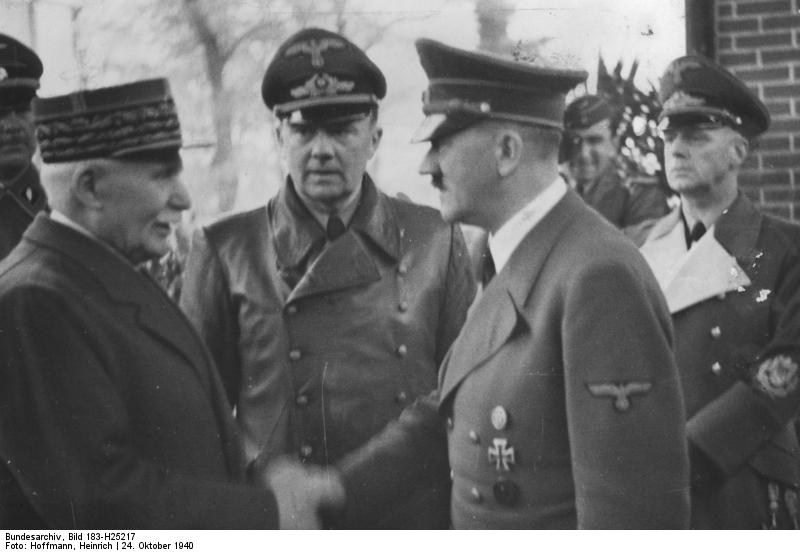Marshal Henri Philippe Petain, left, meeting Adolf Hitler, October 24, 1940, in Montoire-sur-le-Loir, central France. German Foreign Minister Joachim von Ribbentrop is on right.  (1/2)