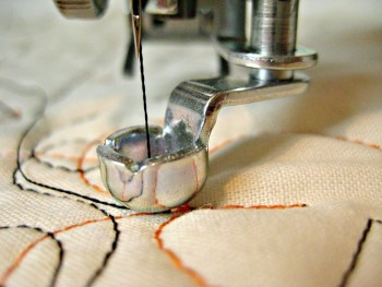 The thickness of the hopping foot on a long arm quilting machine makes it ideal for guiding with a ruler.