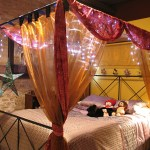 Bedrooms Elegant Black Iron Canopy For Bed Plus Fairy Lights With Captivating Yellow And Pink Sheer Drapes Picturesque Design Beds Canopy Style Helda Site Furnitures Home Design